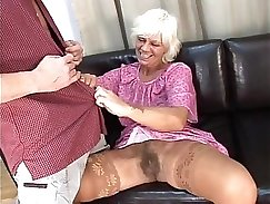 Classy mature hottie pussylicked by young British studs gangbang