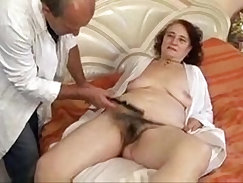 Brunette granny with smashed castigns