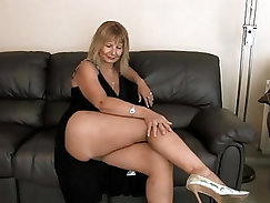 Big titty cougar with tass glasses fingering pussy in porn