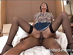 Black cock pounds a blonde mature pussy
