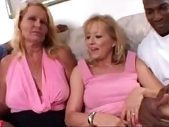 Blonde Moms share a Big Black hard long Cock together in Amateur Threesome Video