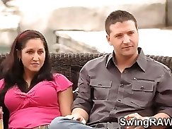 College teen couple having fun in the swing house