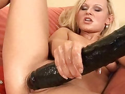 Blonde bomshell Kathy fills her pussy with a massive dildo