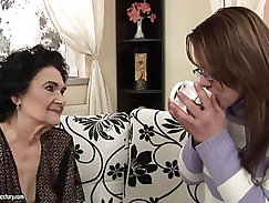 Granny Fucks a Younger Girl with Strap