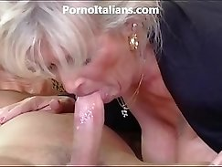Classy milf with fake tits mouthfucking