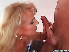 Blonde granny is jerking her member